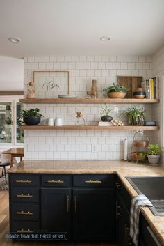 DIY Open Shelving in the Kitchen - Dark cabinets with brass pulls, granite and white subway tile