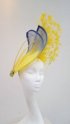 Yellow hatinator blue hat yellow fascinator Mother of the