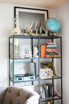 open shelving with unique decor #hometour #theeverygirl