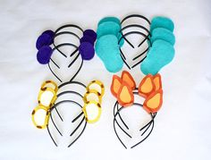 Word party Inspired felt Headbands -Animal ears headbands -Purple, blue, orange and yellow -This listing is for 12 headbands ( three of each color) ***ask for shipping adjustment (if available) on multiple sets before placing the order **** PLEASE TYPE YOUR PARTY DATE IN A NOTE