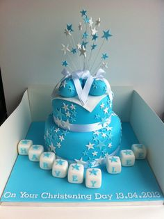 Blue star design double tiered christening cake