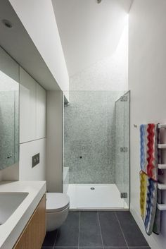 This small bathroom has a standalone bathroom and is lit by a window.