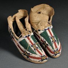 Pair of Cheyenne Beaded Hide Youth's Moccasins
