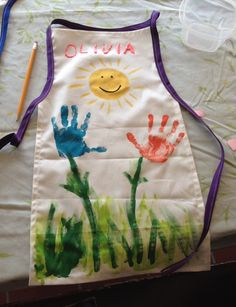 Handprint Apron - aprons made from heavy cotton and double fold tape and painted one sunny morning with Apple Barrel acrylic paints!