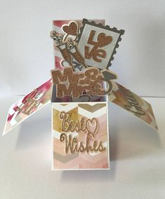 This handmade card is perfect for that special couple on their wedding day. This card is shown with the GIFTCARD HOLDER option which is available at an additional charge. As the recipient removes the flat card from the envelope they will be delighted as the card transforms into a