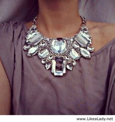 I LOVE this statement necklace!!! I also love the fabric of the dress underneath it!