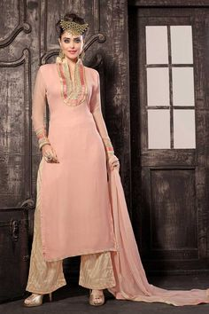 Pink georgette semi stictch trouser suit with price $75.54. Neck embroidered with resham.Chinese collar, Below knee length, full sleeves kameez.Cream trouser with embroidered, resham and zari work.Pink chiffon dupatta with work.It is perfect for party, wedding, festival and ceremonial.  http://www.andaazfashion.us/pink-georgette-trouser-suit-with-chiffon-dupatta-dmv13352.html