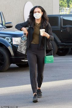 Caffeine break!Britt Stewart got in a pep in her step as she headed to the show armed with a cup of coffee