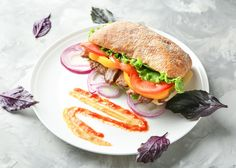 Observed annually on November 3, National Sandwich Day is one of our favourite holidays. The sandwich is believed to be the namesake of John Montagu, the 4th Earl of Sandwich, following the claim that he invented the first-ever sandwich. As one of America's most popular lunch items, this day gives us a great reason to enjoy a sandwich. #SandwichDay #fandbrecipes National Sandwich Day, A Food, Good Food, Lunch Items, B Recipe, November 3, Salmon Burgers, Beverage, Health And Wellness