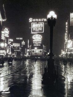 Times Square in the rain, 1923. My grandparents, Giovanna Arpino & Leonard Vena got married in 1923 at City Hall in NYC