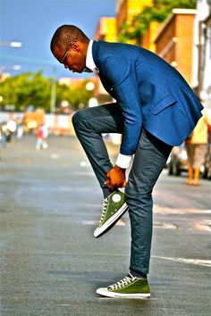 Mens street style fashion: blue jacquard jacket blazer, denim jeans, white shirt, green converse shoes sneakers, bowtie