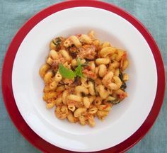 pasta with basil cream sauce and fresh baked tomatoes