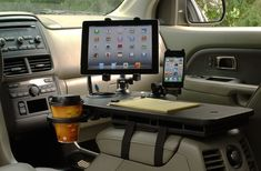 Install a mobile office between your front seats.   36 Things That Will Make Riding In Your Car So Much Better