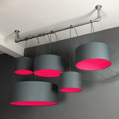 5 way multi way ceiling kit with a range of different sized grey polycotton pendant lampshades with pink neon linings. Perfect for the neon lighting trend.