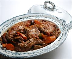 Italian braised rabbit slow cooked with tomatoes, olives, wine and brandy