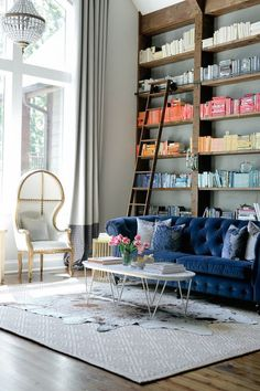 Living Room With Bookcase Around Navy Blue Sofa