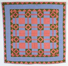 """Geometric Pattern Crib Quilt: Circa 1880: Pa.  What could be more indicative of Lancaster County, Pennsylvania than this crib quilt in blue, pink and green calico? The blocks are actually just diamonds in squares but they are combined with the plain off blocks and blocks with bars to create an entirely new pattern. The double sawtooth border is the ultimate frame for this very geometric quilt. It is un-used, pristine condition. Measurements are 39"""" square; nicely hand quilted"""