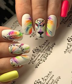 "If you're unfamiliar with nail trends and you hear the words ""coffin nails,"" what comes to mind? It's not nails with coffins drawn on them. It's long nails with a square tip, and the look has. Tribal Nails, Neon Nails, My Nails, Disney Acrylic Nails, Best Acrylic Nails, Cool Nail Designs, Acrylic Nail Designs, Paw Print Nails, Jolie Nail Art"
