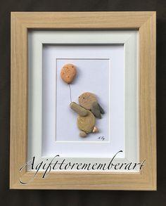 """ little bunny and the balloon"" in a frame! #agifttorememberart #pebbleart #kidsroom #bunny #frame #etsy #etsyshop #roomdecor #makersgonnamake #madebyme #handmadeart #art #instaphoto #instaart #baby #babyshower #giftideas #newbaby #birthdaygift #craft #recycledart #handmadewithlove #beach #australia #nature #stone"