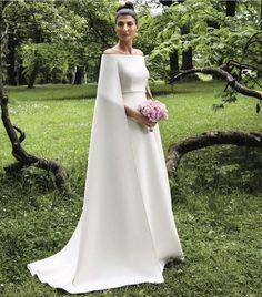 Giovanna Battaglia is caped to perfection in this custom made gown by Maison Valentino  by Lynsey Addario #weddings #weddingslayer