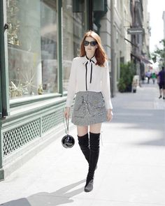 Fall outfit: white blouse with black bow tie, black-white tweed skirt, black overknee boots, black bag