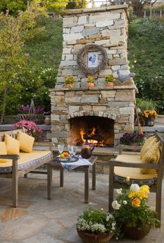 Some of us wish we had this type of fireplace inside our homes, let alone outdoors on a patio. Great way to get the most of your #outdoorliving space.