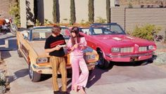 SUNNY & CHER - 1966 With their custom Mustangs.