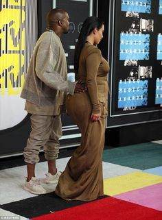 Kind of familiar: Her husband Kanye West put his hand on her famous derriere while she wor. Kim Kardashian Blazer, Kardashian Style, Kardashian Jenner, Kim Kardshian, Cocktail Attire For Women, Kanye West And Kim, Black Couples Goals, Olive Green Dresses, Indian Beauty Saree