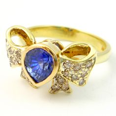 Vintage 14K Blue Sapphire and Fancy Champagne Diamond Bow Cocktail Ring. $650.00, via Etsy.