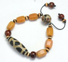 Antique Style Tibetan Dzi and Jade Beads Protective Amulet Bracelet - Fortune Feng Shui Jewelry Fortune Jewelry & Healing Beauty,http://www.amazon.com/dp/B00CMLNNM2/ref=cm_sw_r_pi_dp_8BKytb0VGK45AMND