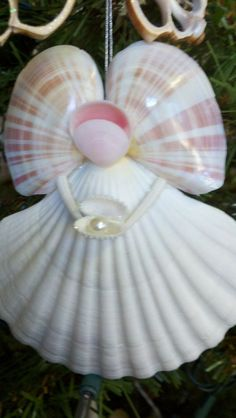 Angel holding a pearl Ornament by SeaThingsVentura on Etsy, $16.50:
