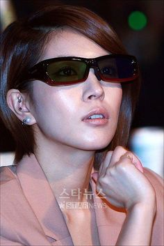 BoA Kwon known as Queen of Kpop sophisticated look, with her bobbed hair, shade, and beautiful earrings,
