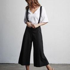 The Culottes are probably our favorite thing we've made so far, and the thing that we wear the most. The high waist, elastic in back, and loose fit make these our most comfortable go-to pant. Yet they look really polished and put together at the same time. You can wear The Culottes in casual settings, lounging around the house, or to the office. A foundational item for your capsule wardrobe. DETAILS - Made in NYC by a family-run factory (learn more here) - Tencel/cotton - Dry clean. View our…