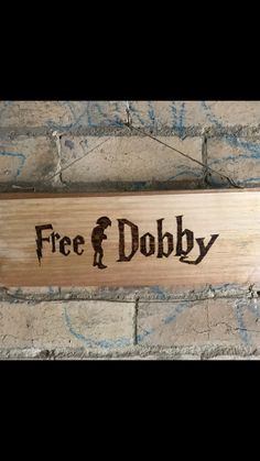 Here is a finished photo of the free dobby sign, made out of recycled wood. Making these to order if anyone is interested