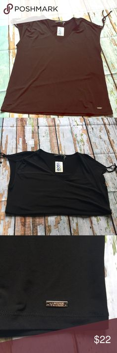 BNWT Cold Shoulder Short Sleeve Blouse Pretty black blouse with cold shoulder and tie accents. Silver plated accents. Great for the office! Ivanka Trump Tops