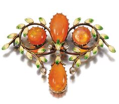 FIRE OPAL, ENAMEL AND DIAMOND BROOCH, CIRCA 1900, Of foliate design, set with cabochon fire opals, the leaves decorated with guilloché green and white enamel, highlighted with rose diamonds.