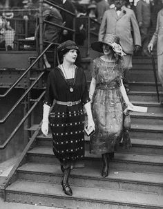 Women in 1920s Style Clothing Two women in 1920s style, loose fitting dresses, brimmed hats and rolled stockings. Photographer: Underwood & Underwood Date Photographed: 1920s Location Information: Probably New York, New York, USA