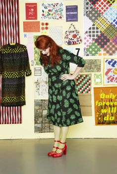 Designer Lotta Kühlhorn. I love everything about this photo - talented woman, lots of patterns, color everywhere. Makes me so happy to see this.