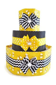 """This 3 tiered bumble bee themed diaper cake will be a show stopper at your next baby shower! It compliments a """"What Will It Bee"""" gender reveal party. It's perfect as a centerpiece for a dessert or gif"""