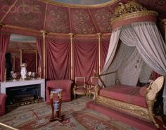 Josephine's Chamber at Chateau de Malmaison, with its pink decorative scheme, is considered to be one of the most beautiful rooms in the Empire style.