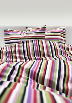 2014 Pantone Color of the Year - Radiant Orchid - This versatile shade plays well with other colors, as shown in the multi-color stripes of the DVALA duvet.