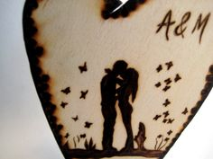 Rustic wedding cake topper -Couple, love and butterflies -Customized. $19.65, via Etsy.