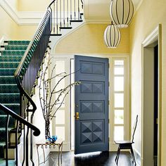 blue interior door with pale yellow walls; love the pendant lights and stair runner