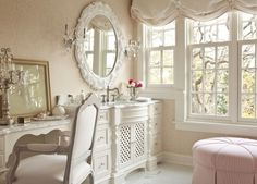 I like so much about this room. + tailored pail pink ottoman + ornate white mirror + fanciful candlestick near chair + lattice front on the bureau + swag window treatments - I've always liked that particular style. + Antique-style chair It's a room I could easily start & end each day in. Just Lovely!