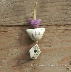 Handmade ceramic house in purple