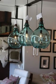 Awesome blue glass lights. Would be perfect over a kitchen island or bar!
