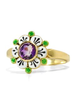 An early-twentieth-century ring in the Suffragette symbolic colours of green, purple and white.