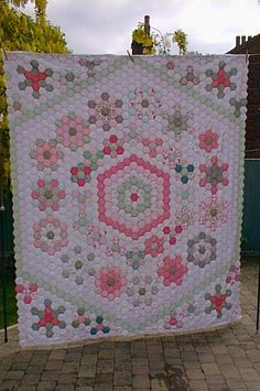 Made with English paper piecing hexagons.                                                                                                                                                      More