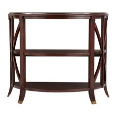 Pavilion Console Table - Antique Mahogany     The Bombay exclusive Pavilion antique mahogany console table is a smart storage addition behind a sofa or in an entry hallway. Three surfaces display art or decorative items. Cross bar and quarter panel veneer detail, and curved feet with brass tips adds elegance.        Modified density fiberboard, hardwood, veneer      Assembly required