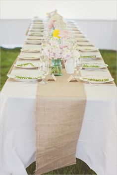 rustic wedding decor. Head table idea: lace on the ends and a purple ribbon running down the center of the burlap!